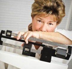 Por Que Algumas Mulheres Ganham Peso Em Torno da Menopausa